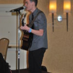 Dylan Brady sings at the event